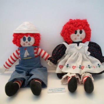vintage handmade Raggedy Ann and Raggedy Andy dolls with porcelain face and hands