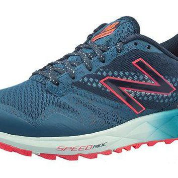 DCCK1IN new balance women s wt690v1 trail shoe teal pink 7 5 b m us