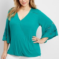 plus size wrap front blouse with detailed bell sleeves | maurices