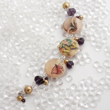 Butterfly Bracelet with Gold Pearls and Purple Crystals - Resin Jewelry
