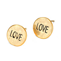 "golden 'love' button post earrings at Joji Boutique: 1/2"" gold discs with ""LOVE"" etched in. Offset post. #jewelry #joji #fashion #gifts"