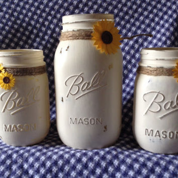 """Painted mason jars.Set of 3 Mason Jars. One quart 2 pint. Painted with Annie Sloan Chalk Paint """"old white""""with jute and sunflowers."""