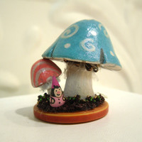 Girl Gnome sitting under a pair of mushrooms by workofwhimsy
