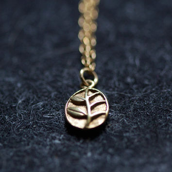 $34.00 the memory little gold leaf necklace by by elephantine on Etsy