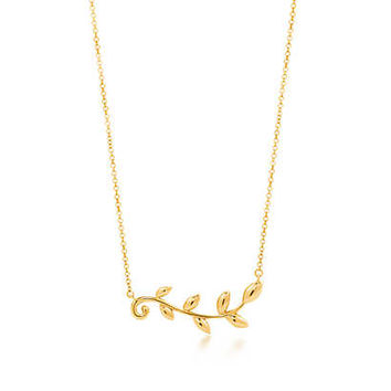 Tiffany & Co. - Paloma Picasso® Olive Leaf vine pendant in 18k gold.