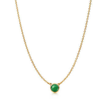 Tiffany & Co. - Elsa Peretti® Cabochon pendant in 18k gold with green jade.