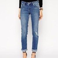 ASOS | ASOS Kimmi Shrunken Boyfriend Jeans in Rio Vintage Wash With Ripped Knee at ASOS