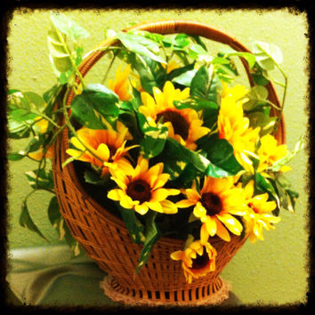 Handmade artificial floral arrangement : basket full of sunflowers.