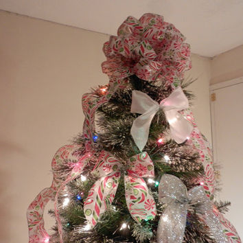 Large Christmas Tree topper bow made with a  white ribbon with  red and green christmas Candy printed on it  and 12 ornament bows