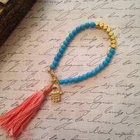 Turquoise and gold yoga friendship bracelet with hamsa and coral tassel