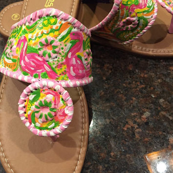 Painted sandals inspired by the style of Jack  Rogers and painted with a Lilly Pulitzer like design.