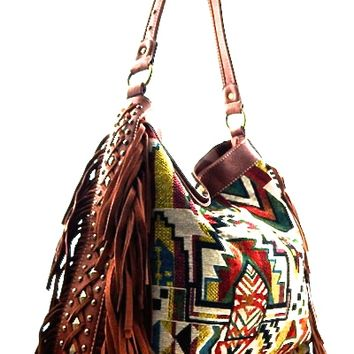 Featuring Navajo print on tapestry main fabrication, leatherette piping accent, two of genuine leather fringe and antique gold-tone studded embellishments, wide open top with zipper closure, one interior zipper divider at center, one interior zipper pocket