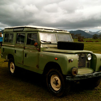 Vintage OLD Rustic Green Land Rover Car in Dusk Rainy Photograph setting