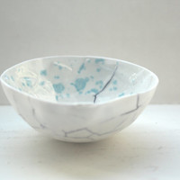 Decorative stoneware fine bone china bowl with blue cracks and glossy interior with blue speckles