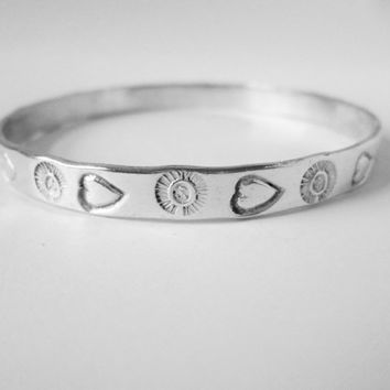Vintage Taxco Mexico Sterling Silver Bangle Bracelet Impressions of Hearts and Suns Motif Made Solid Not Flimsy Appealing Design VGC