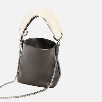 MINI CROSSBODY BAG WITH A STRAP DETAIL DETAILS