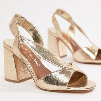 River Island Wide Fit block heeled sandals in gold at asos.com