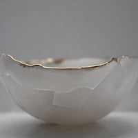 Paper thin bowl made out of fine bone china looking like curled leaf with 10% real gold.
