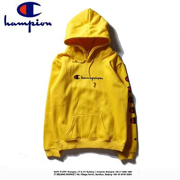Champion autumn and winter models men and women loose hooded long-sleeved sweater yellow