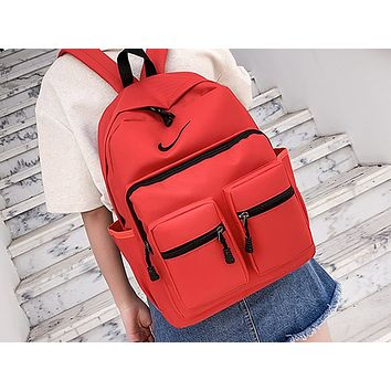 NIKE popular men's and women's casual backpacks fashion stitching large capacity shopping backpack Red