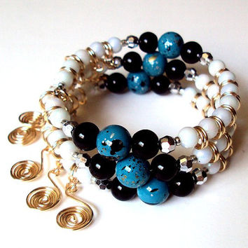 Turquoise black and white beaded bauble stacked spiral memory wire wrap bracelet with gold tone coiled wire charms