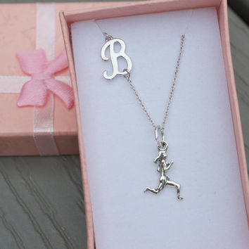Off center initial necklace in sterling silver and personalized further with running girl charm. Runner charm.  Initial Necklace. Sterling.