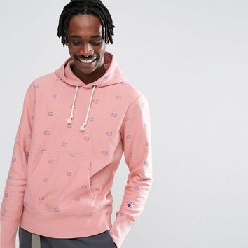 Champion Hoodie With All Over Logo Print In Pink Exclusive To ASOS at asos.com
