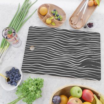 minimal movement Cutting Board by duckyb