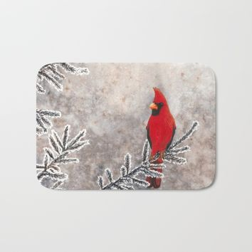 The Red Cardinal in winter Bath Mat by Savousepate