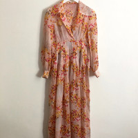Vintage 1970s bright floral print sheer maxi dress with bishop sleeves and stitched waist pleats