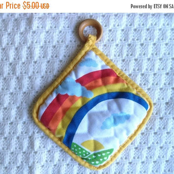ON SALE Rainbow pot holder/ vintage rainbow and clouds quilted potholder with wood ring and yellow