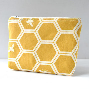 Padded make up pouch Honey bee hive print in mustard yellow in large.