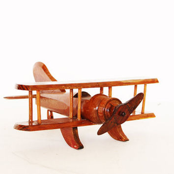 Vintage caramel brown plane toy folk art