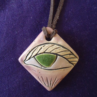 The Wise Eye. Handmade pottery pendant, ceramic necklace. Green eye. White clay.