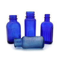 Vintage blue glass small apothecary drug store bottle collection