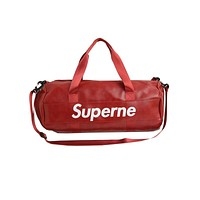 Supreme street fashion men and women full-letter travel bag tote red
