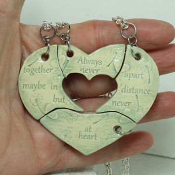 Friendship pendants set of 4 puzzle pieces Heart with friendship quote Always together never apart light teal
