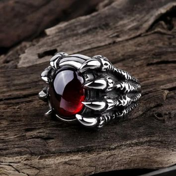Silvery Claw Holding Skull Stone Ring