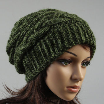 Hand knitted ladies slouchy beanie. A lovely hat available in green.