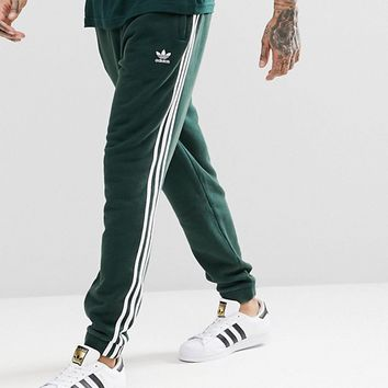 adidas Originals adicolor 3-Stripe Joggers In Green CX1898 at asos.com