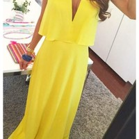 Blakely - Strapless yelow maxi dress with deep v neck