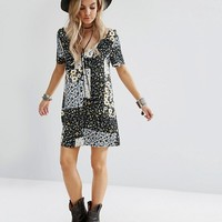 Glamorous Petite Button Front Tea Dress In Patchwork Floral Print at asos.com