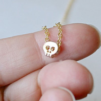 simple tiny gold skull necklace