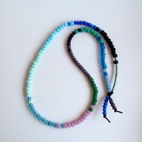 Long beaded necklace multi-colored glass Native American 'crow' beads in blues greens and pink Spring fashion boho trends An Astrid Endeavor