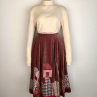 Vintage 1980s gathered brown velvet skirt with landscape appliqué and side pockets