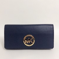 Michael Kors Fulton Carryall Pebbled Leather Flap Wallet In Admiral Blue