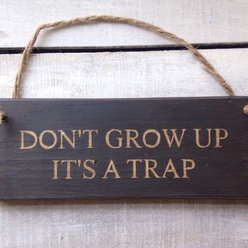 Funny Sign. Funny Gift. Rustic Sign. Don't Grow Up It's A Trap.