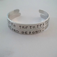 "Custom set of 2 hand stamped aluminum bracelet cuffs 1/4"" by 6"" to infinity and beyond toy story friendship"