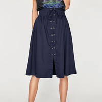 SKIRT WITH METAL GROMMETS