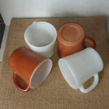 Four milk glass mugs, two white, two brown, anchor hocking